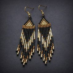 Long seed bead earrings. Black and gold dangle earrings with fringe. These earrings made with japanese seed beads. Ear wires are surgical steel. Length - 9,5 cm / 3.7 inches (including ear wires). Width - 2 cm / 0.8 inches More seed bead earrings from my shop you can see here: