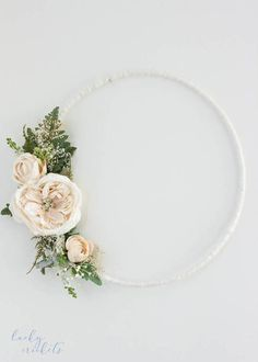 Floral hoop decor is so beautiful and chic for your home, office or nursery. > Beautiful cluster of flowers accent the flower hoop dreamcatcher for a lovely boho feel. > Soft colors, ivory flowers contrasted with rich greenery. > Boho floral hoop is 14 inches in diameter. > Chiffon