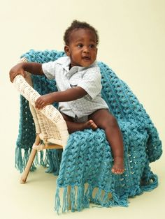 Free Pattern - Hairpin lace uses a loom to make a beautiful multi-stranded fabric. Learn how with this #crochet blanket in Bernat Softee Baby.