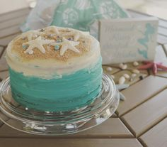 Clover's birthday cake, blue ombré with sand and star fish. Made by mom…
