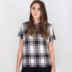"""The Fifth Tartan Plaid Jersey Short Sleeve Top Designer carried by Nasty Gal. The Building Blocks T-shirt is a casual tee with a bound neckline and a loose fit. The lightweight T-shirt is available in The Fifth's exclusive tartan print.  Main: 95% viscose / 5% elastane Exclusive Tartan Print Designed in Australia Measurements:   Small: Overall Length 25"""", Waist 36"""", Bust 36"""" Medium:  Overall Length 28"""", Waist 40"""", Bust 40"""" Nasty Gal Tops Tees - Short Sleeve"""