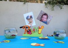 Table decorations with real fish!! Also a fish craft for the kids to make.
