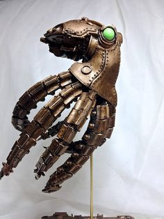 Sculpture of a robotic steampunk octopus, with bright green eyes and a finish of metallic brass over the detailed mechanical body. Statue is tall, cast in resin and hand painted, hovering above a base from a brass rod. Arte Steampunk, Steampunk Octopus, Steampunk Robots, Steampunk Crafts, Steampunk Design, Steampunk Fashion, Robot Animal, Steampunk Animals, Octopus Art