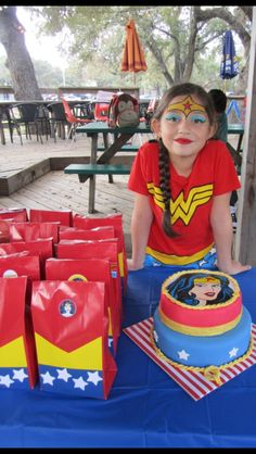 Wonder Woman Party. Candy bags, water bottle & cake