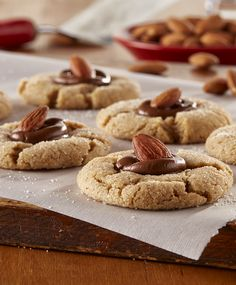 Almond Blossom Cookies from Land O'Lakes - Inspired by a Christmas cookie favorite - this spiced almond butter cookie is topped with a milk chocolate candy kiss and whole almond. Nut Recipes, Sweet Recipes, Cookie Recipes, Dessert Recipes, Pumpkin Cookies, Holiday Cookies, Holiday Treats, Christmas Treats, Cookies