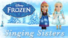 """http://www.blurootoys.com  Disney's Frozen Princesses, Anna and Elsa sing in both English and Spanish. Watch our Anna and Elsa Doll videos to see the Frozen singing doll set in action. They light up and have different bilingual phrases. Elsa sings, """"Let It Go,"""" and Anna sings, """"Do You Want to Build a Snowman?"""""""