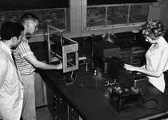 The State University of New York awarded one-quarter of the Oyster Bay faculty research grants in 1958. Newly hired professor Dr. Joseph Silverman of the Chemistry Department is pictured here in a laboratory with two Natural Science I students.