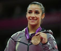 Alexandra Raisman of the U.S. celebrates winning a bronze medal in the women's gymnastics balance beam