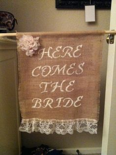 the Here Comes the Bride burlap and lace banner I made for our wedding for our 2nd ring bearer to hold!