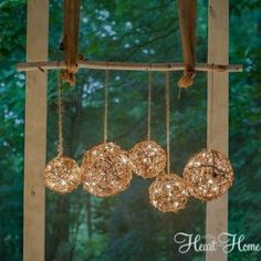 Easy DIY Outdoor Chandelier - All Things Heart and Home - DIY: How to Create Rustic Outdoor Lighting – using string lights and grapevine balls. This is an easy and clever way to add lighting to a porch – via All Things Heart and Home Outdoor Chandelier, Hanging Chandelier, Chandelier Ideas, Ribbon Chandelier, Branch Chandelier, Hanging Lights, Diy Porch, Diy Patio, Patio Ideas