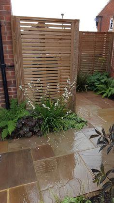Hiding Rubbish Bins with Jacksons Venetian Fencing. A great garden idea using fence screening.