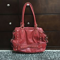 Jessica Simpson Purse Handbag Hand bag Studded Used. Noticeable signs of wear on corners and handles of purse. Pink stain on interior. 1 exterior pocket and 3 interior (1 with zipper). Jessica Simpson Bags