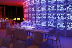 How to Bring an Abstract Event Theme to Life  Word art displayed in various forms throughout the gala conveyed an abstract event theme. The lighting on a curved wall changed colors every...