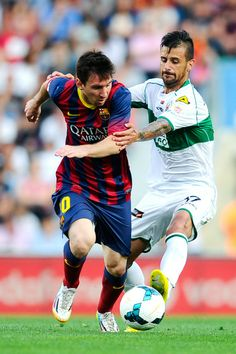 Lionel Messi of FC Barcelona competes for the ball with Javi Marquez of Elche FC during the La Liga match between Elche FC and FC Barcelona at Estadio Manuel Martinez Valero on May 2014 in Elche, Spain. Fc Barcelona, Argentina National Team, Messi Photos, Leonel Messi, Good Soccer Players, Messi 10, National Football Teams, Soccer World, Sports Stars