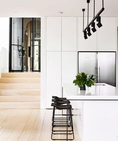 Gorgeous modern kitchen with lots of storage and modernized track lighting - clean simple lines.