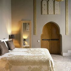 This is how you sleep when you have some money lying around. Hand sculpted Moroccan Cedar wood door, Hand embroidered Satin bedsheets, a beautiful brass mirror and pretty wall engravings.