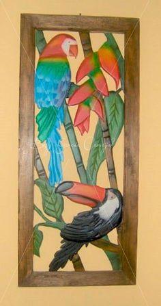 Loro y tucan. calado y tallado en madera.