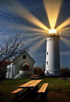Denmark  - love how the photo captured the light coming out of the lighthouse.
