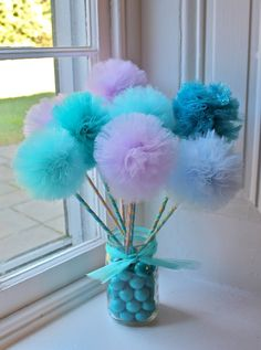 poms to hang from the ceiling or these for table decorations