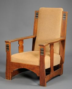 Arts & Crafts upholstered oak armchair with pewter and ebony inlay. (possibly Luce Furniture Co.)