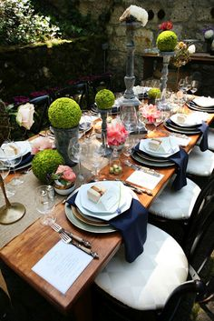 "Modern ""topiary"" table setting. Cover foam balls with spray glue and moss, set on top of random candlestick holders."