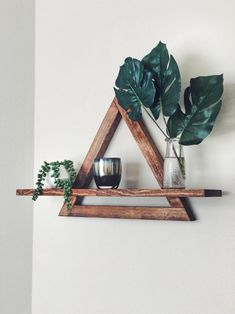 Gorgeous handmade cedar triangle shelf by IansFurniture. Perfect to display your pictures or collection of plants. Diy Wood Projects, Home Projects, Home Crafts, Diy Crafts, Diy Wall Decor, Diy Home Decor, Room Decor, Geometric Shelves, Triangle Shelf