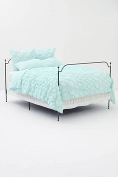 This quilt would be awesome with pops of red pillows! Catalina Quilt, Aqua - Anthropologie.com