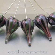 This listing is for a single handmade lampwork glass teardrop head pin. I made these glass head pins using a dark transparent dark grey base with red