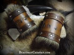 Welcome to my shop, friend!  These cuffs are hand tooled with runes from the Elder Futhark, and are completely customizable. I can fit up to six runes of your choosing on these cuffs. Also, the cuffs attach via buckles and have a faux fur trim. Each order comes with a single cuff. Please specify the runes you would like in the comments of the purchase. Every product is made the hard way, completely by hand. I start out with natural, vegetable tanned leather in the optimal thickness for the…