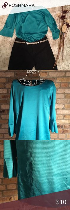Ann Taylor Green Blouse Beautiful green top. 3/4 sleeves. Some pulling (most of it in the lower back-must be from tucking it in the pants). Also the hem got loose, which was no problem for me as this Blouse looks best tucked in. 98% polyester, 2% spandex. Ann Taylor Tops Blouses