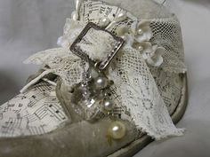 Altered baby shoes. Found on vintiquitiesworkshop.blogspot