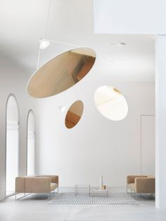 The circular aluminum Amisol light by Daniel Rybakken for Luceplan