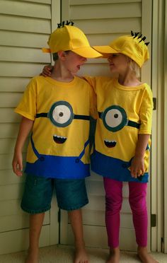 Minion shirts and hats made with pipe cleaners, freezer paper stencils, acrylic paint, and a whole lot o' masking tape.