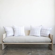 Farrah Sit's beautifully simple maple wood sofa decked out in Rebecca Atwood fabrics, now available via WorkOf. | Lonny