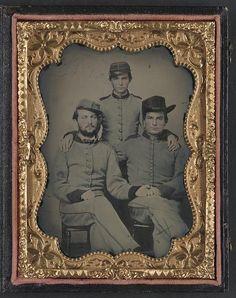 Three soldiers in Confederate artillerymen uniforms
