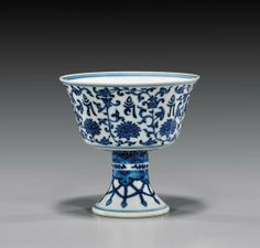 """Antique Chinese Qianlong Period, blue and white porcelain stem cup; in the form of a Tibetan yak butter stem cup; of Buddhist motif, with a floral wheel to the interior, the exterior with otus blossoms and characters, and beaded garlands to foot; mark to base, 18th Century; H: 4 1/8"""""""