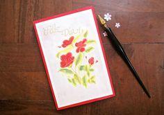 Tarjeta flores con acuarelas y caligrafía