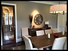 My lovely new dining room in my Houston house following a year of remodeling. A much  more contemporary feel with soft gray and creams to go with walnut floors. Read more at my blog  No Fixed Abode 4 Sue