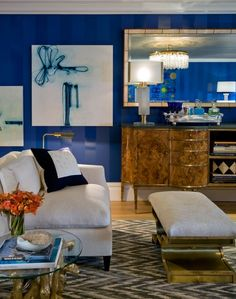 Royal lacquered walls - love the blue and the furniture mix. Designer Sherrill Canet.