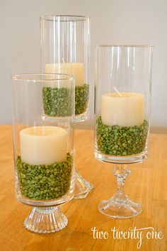 hurricane jars with split peas and candle centerpieces. You could do a slightly smaller candle inside and spray with spray adhesive and coat in a fine pink glitter (at craft store). Also can monogram initials in pink with vinyl or etching cream and or tie pink ribbon or bow around...
