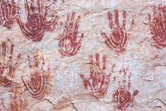 Painted Ancestral Pueblo rock art handprints, Canyonlands, Utah.