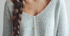 Grey fall sweater paired with a gold heart pendant and a lovely long braid.