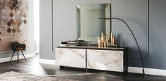 Sideboard with sliding doors and insert into the top in ceramic Marmi Calacatta (KM01), Alabastro (KM02) or Ardesia (KM04). Matt graphite (OP69) or white (OP71)