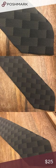 Armani Geometric Handmade Italian Silk Tie Giorgio Armani S.P.A. is an Italian fashion house founded by Giorgio Armani which designs some of the most sort after haute couture products in the luxury world.The brand utilizes the association of the Armani name with high-fashion, benefiting from its prestige in the fashion industry. Armani ties are the apex of Italian fashion. This is a vintage hand-sewn Armani tie featuring a geometric pattern. Giorgio Armani Accessories Ties