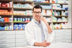 [ Portrait Of A Young Atrractive Friendly Male Pharmacist With A Smartphone. Presentation Skills, Job Opening, Smartphone, Medical, Stock Photos, How To Make, Fluent English, Male Man, Team Member
