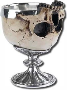 The goblet was used to try to poison Gertrude and Hamlet by Claudius. The skull in this picture also shows the death of the characters during the fight.