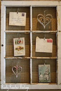 Old window idea - love the use of sheer clips to hold the items on the chicken wire.
