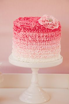 Pretty pink ombre + fondant flower with ruffles. Learn to make cakes just like this here: www.mycakedecorating.co.za