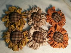 Flowers galore!! You will receive 6 handmade flowers. Two are made from yellow, two are made from orange and two are made from an unbleached muslin fabric with a brown homespun checked center made to look similar to a daisy. They have been grunged with a mixture of coffee and spices. Each one is approximately 5 inches wide. They would look great attached to a wreath or just adding color to a bowl.  Be sure to look at my other handmade items. You may see something that catches your eye. I…
