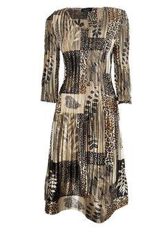 Guldskimrande klänning med vackert mönster